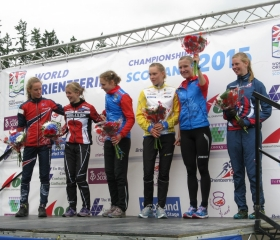Great Britain's Cat Taylor on the podium after taking sixth place in the Women's Long race WOC2015, Grahame Nicoll
